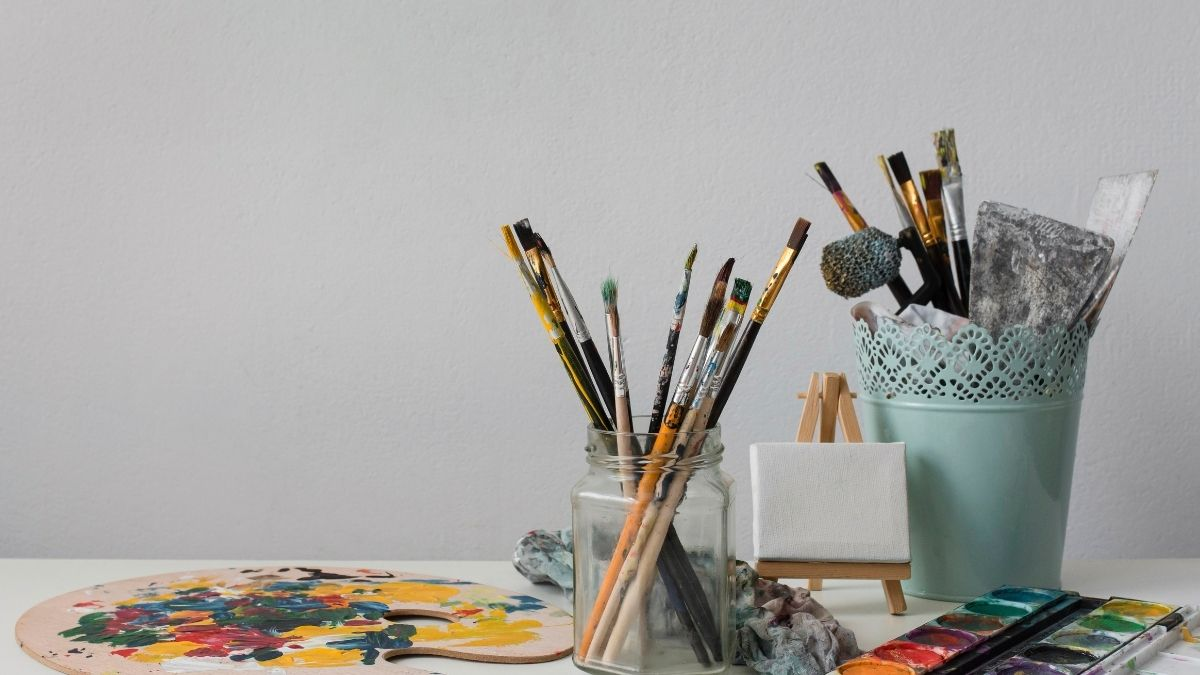 Watercolor supplies on a white table
