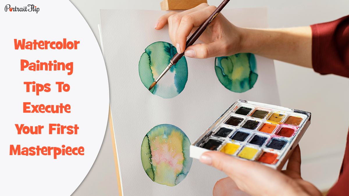 Watercolor Painting Tips : A person painting beautiful spheres on a watercolor paper while holding watercolor cakes in one hand.